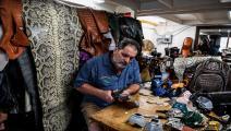 فلوريدا.. براين وودز يصنع كمامات من جلد الزواحف (Getty)