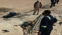 جثث مستخرجة من آبار صحراء الأنبار (فيسبوك)