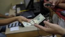 الدولار أكثر عملات الديون شيوعاً في العالم (Getty)