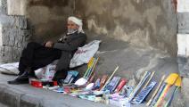 سورية-الفقر في سورية-أسواق سورية-بائع سوري-10-21-فرانس برس