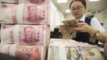 الدولار واليوان الصيني (Getty)