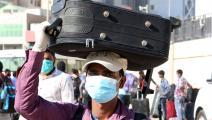 عمال في الكويت فيروس كورونا YASSER AL-ZAYYAT/AFP
