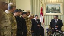 الرئيس الراحل مرسي ورئيس حكومته هشام قنديل (فرانس برس)