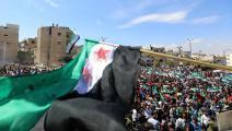 مظاهرة في إدلب (عمر حج قدور/فرانس برس)