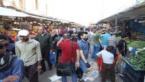 تزاحم في أسواق العراق (يونس كيليس/الأناضول)