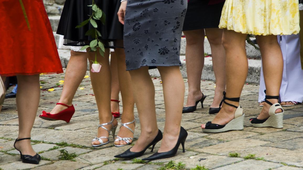 نساء يلبسن تنانير وفساتين (ألدو بافان/Getty)