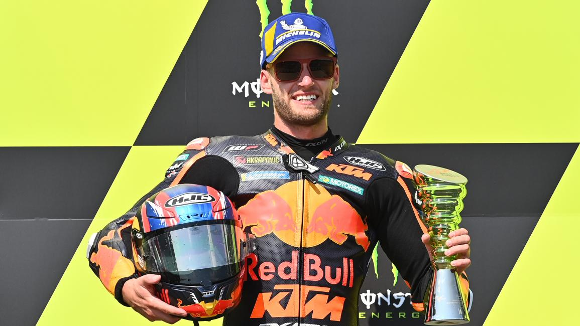 Winner Red Bull KTM Factory Racing´s South African Brad Binder celebrates during the winner's ceremony after the Moto GP Czech Grand Prix at Masaryk circuit in Brno on August 9, 2020. (Photo by Joe Klamar / AFP) (Photo by JOE KLAMAR/AFP via Getty Images)