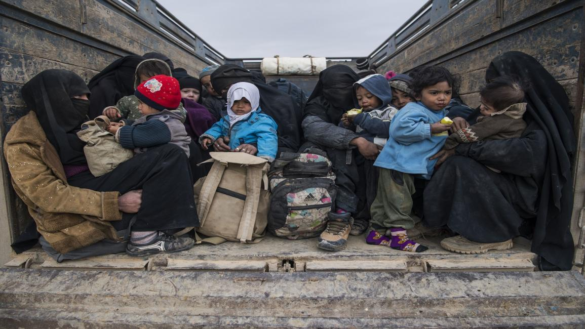 TOPSHOT-SYRIA-CONFLICT-IS TOPSHOT - Women and children who fled the Islamic State (IS) group's embattled holdout of Baghouz on February 14, 2019, wait in the back of a truck in the eastern Syrian province of Deir Ezzor. - IS jihadists using tunnels and suicide bombers were mounting a desperate defence today of their last square kilometre in eastern Syria. Kurdish-led forces closed in on the small town of Baghouz where IS fighters and their relatives were hunkered down and met famished and dishevelled people