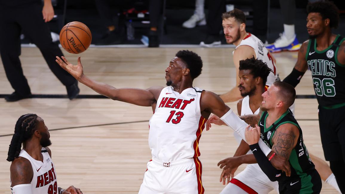 LAKE BUENA VISTA, FLORIDA - SEPTEMBER 17: Bam Adebayo #13 of the Miami Heat fights for possession during the third quarter against Daniel Theis #27 of the Boston Celtics in Game Two of the Eastern Conference Finals during the 2020 NBA Playoffs at AdventHealth Arena at the ESPN Wide World Of Sports Complex on September 17, 2020 in Lake Buena Vista, Florida. NOTE TO USER: User expressly acknowledges and agrees that, by downloading and or using this photograph, User is consenting to the terms and conditions of