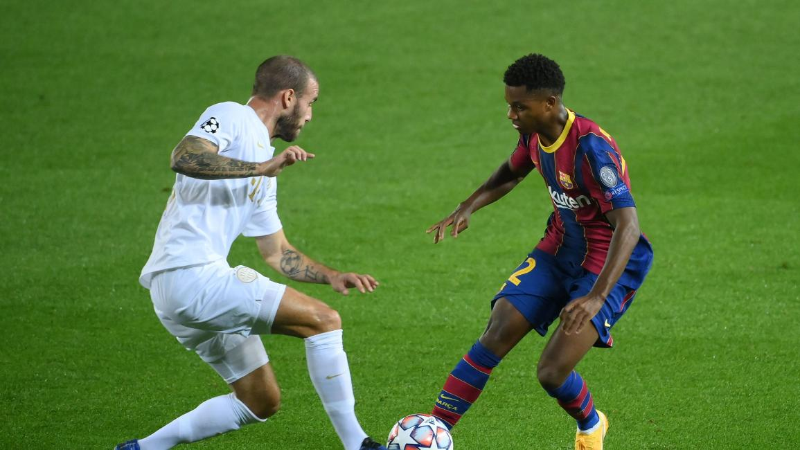 Ferencvaros' Slovenian defender Miha Blazic (L) challenges Barcelona's Spanish forward Ansu Fati during the UEFA Champions League football match between FC Barcelona and Ferencvarosi TC at the Camp Nou stadium in Barcelona on October 20, 2020. (Photo by LLUIS GENE / AFP) (Photo by LLUIS GENE/AFP via Getty Images)