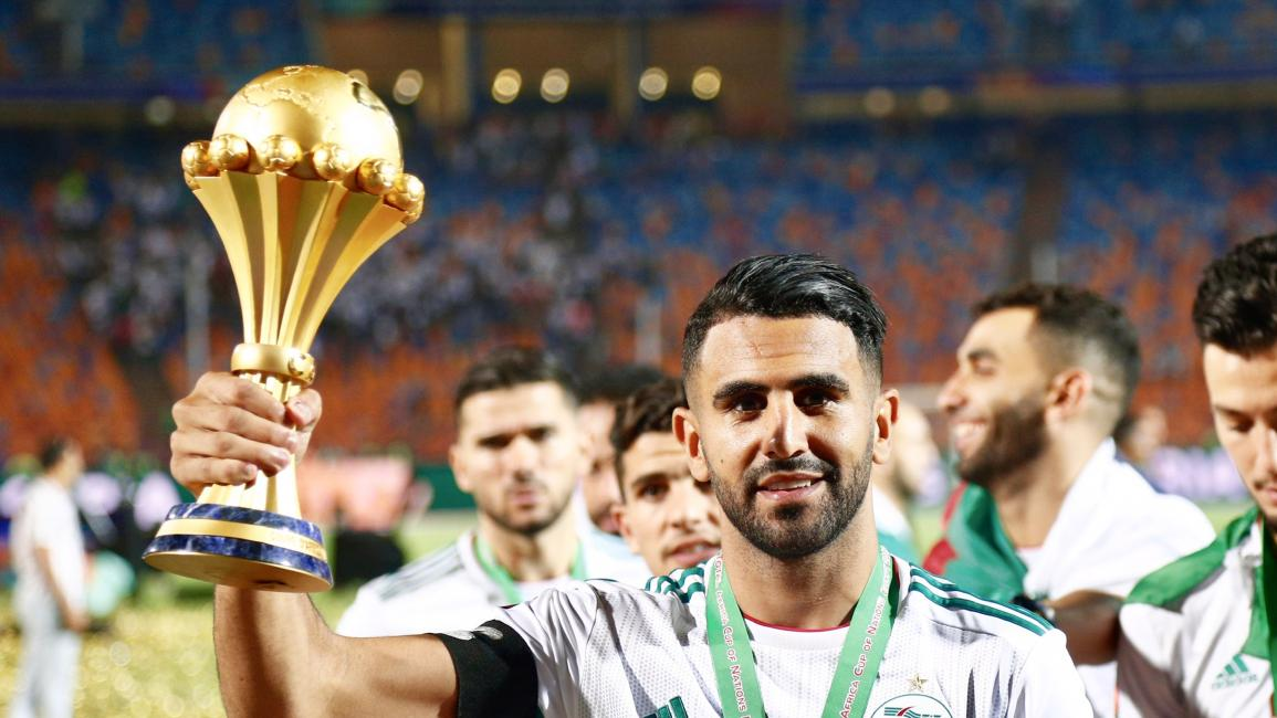 Algeria's Riyad Mahrez celebrates with the trophy during the award ceremony after Algeria defeated Senegal in the 2019 Africa Cup of Nations final soccer match at the Cairo International Stadium, in Cairo, Egypt, on 19 July 2019. (Photo by Islam Safwat/NurPhoto via Getty Images)