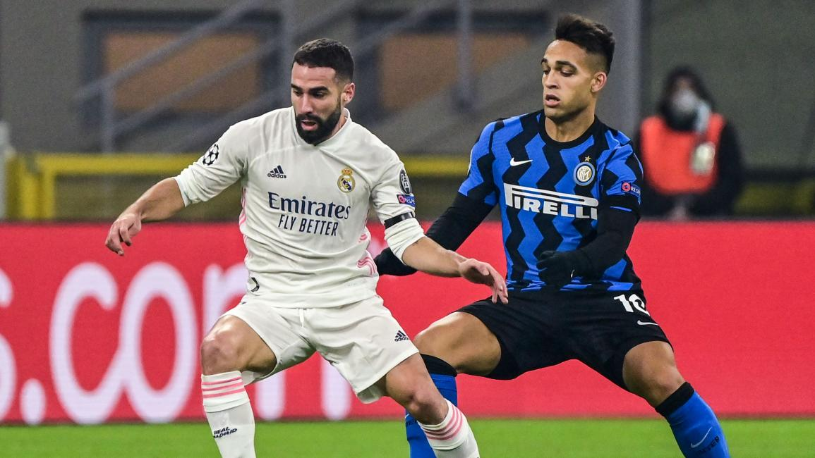 Real Madrid's Spanish defender Dani Carvajal (L) works around Inter Milan's Argentine forward Lautaro Martinez during the UEFA Champions League Group B football match Inter Milan vs Real Madrid on November 25, 2020 at the Giuseppe-Meazza (San Siro) stadium in Milan. (Photo by MIGUEL MEDINA / AFP) (Photo by MIGUEL MEDINA/AFP via Getty Images)