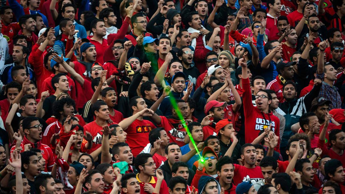 Egypt Al-Ahly fans chant slogans in support of their team ahead of their African Super cup final football match against Tunisia's Club Sportif Sfaxien in Cairo on February 20, 2014. AFP PHOTO / MOHAMED EL-SHAHED (Photo credit should read MOHAMED EL-SHAHED/AFP via Getty Images)