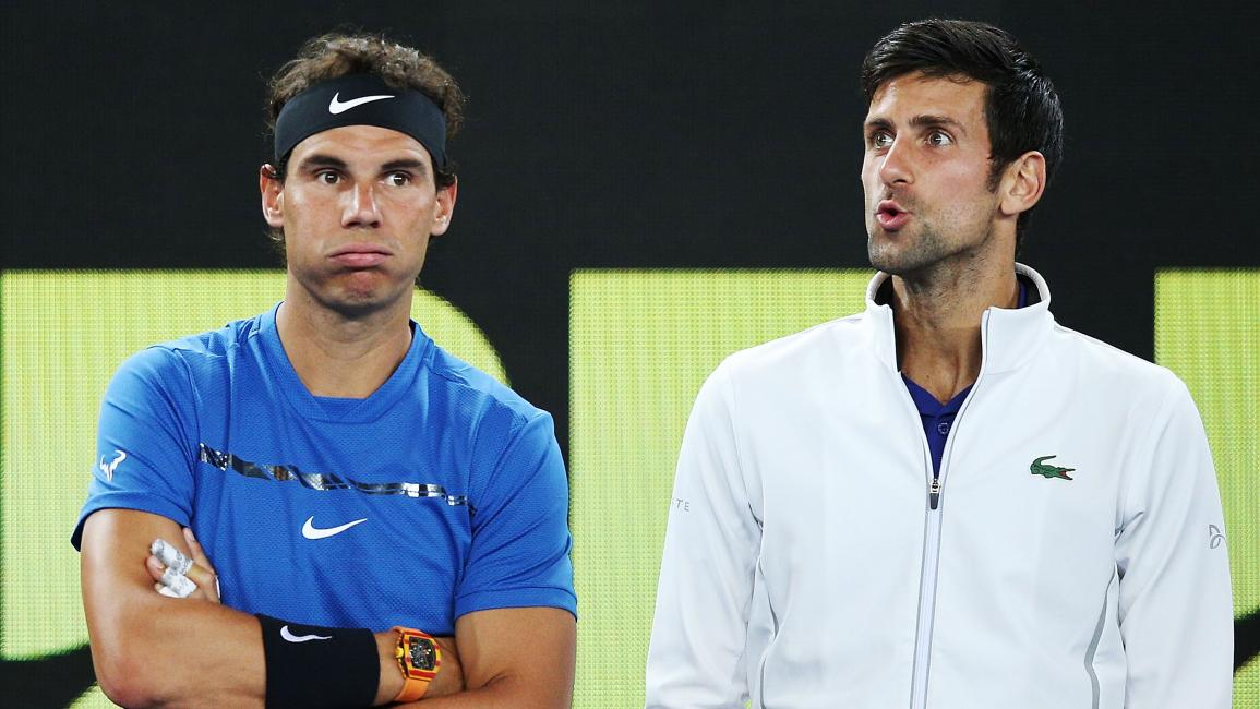 MELBOURNE, AUSTRALIA - JANUARY 10: Rafael Nadal of Spain (L) and Novak Djokovic of Serbia hits a forehand react after watching a video replay while on the sidelines during the Tie Break Tens ahead of the 2018 Australian Open at Margaret Court Arena on January 10, 2018 in Melbourne, Australia. (Photo by Michael Dodge/Getty Images)