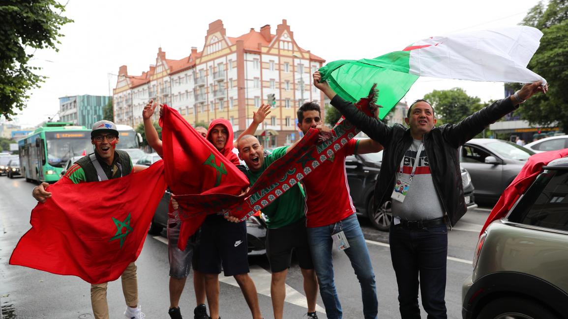 KALININGRAD, RUSSIA - JUNE 25, 2018: North African football fans with national flags of Morocco and Algeria before a 2018 FIFA World Cup Group Stage football match between Spain and Morocco. Vitaly Nevar/TASS (Photo by Vitaly Nevar\TASS via Getty Images)